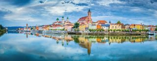 Passau city panorama with Danube river at sunset, Bavaria, Germa