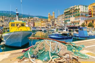 Traditional fishing boats in Bastia port on sunny summer day, Co